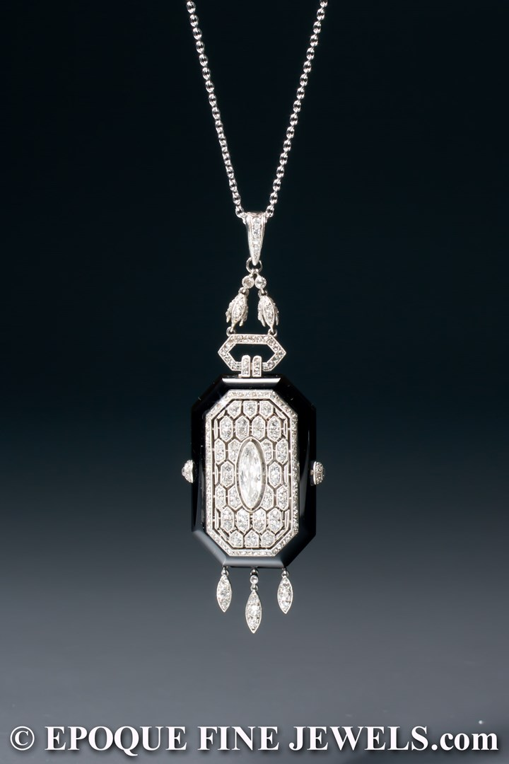 A very rare Art Deco onyx and diamond pendant watch