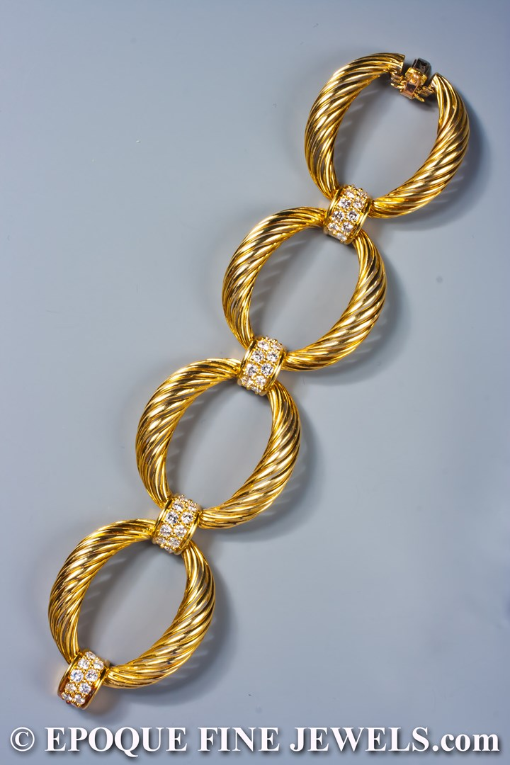 An impressive 18 karat yellow gold and diamond bracelet,