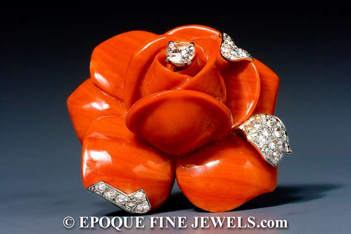 A striking coral and diamond flower brooch