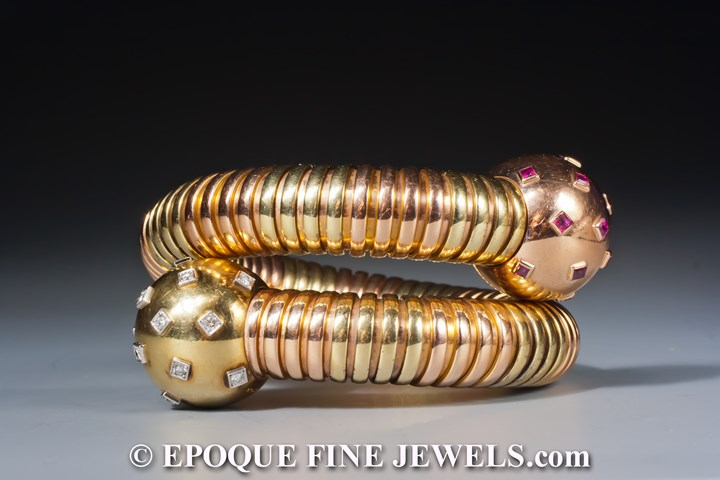 An exquisite two-colored gold tubogas bracelet with ball terminals,