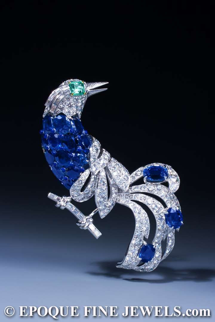 An impressive sapphire, emerald and diamond bird brooch