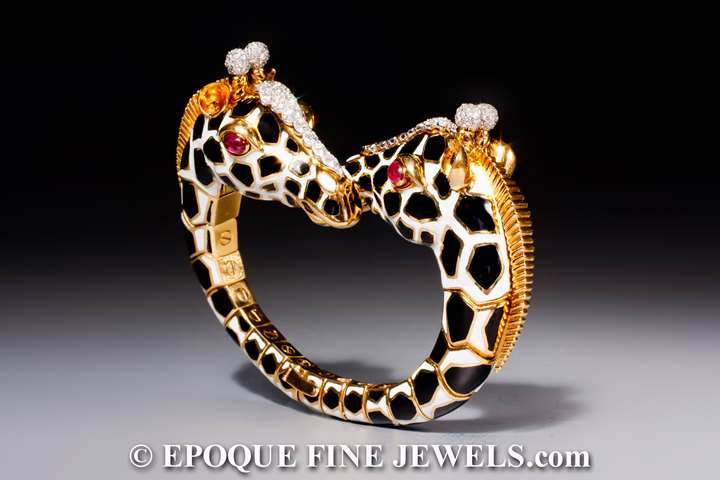 A magnificent twin giraffe bracelet of crossover design