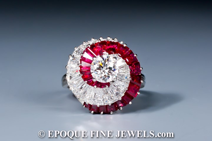 An unusual ruby and diamond swirl ring