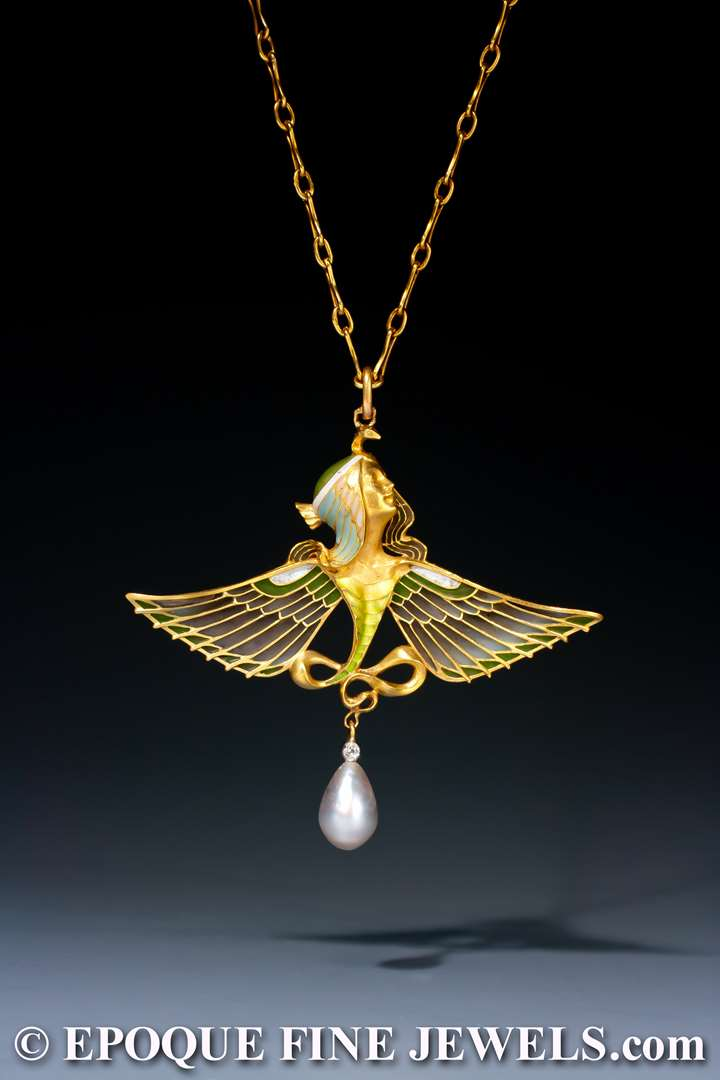 An Art Nouveau gold, enamel, plique-à-jour enamel, pearl and diamond pendant