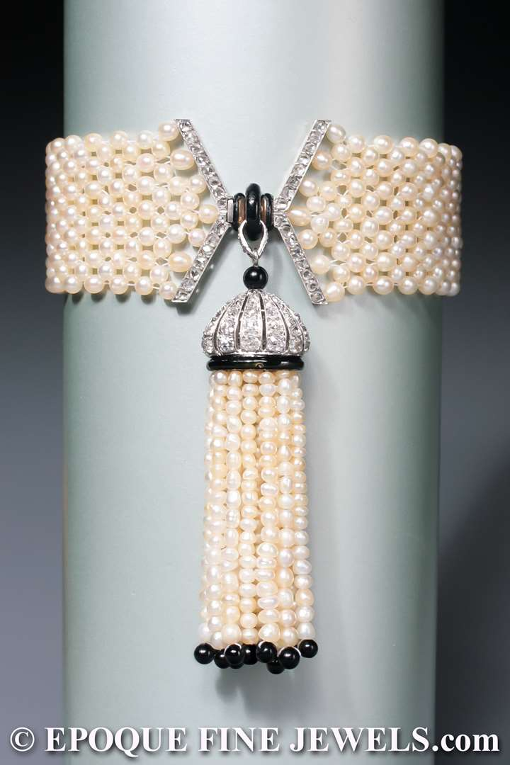 An early Art Deco natural pearl, enamel, onyx and diamond tassel bracelet