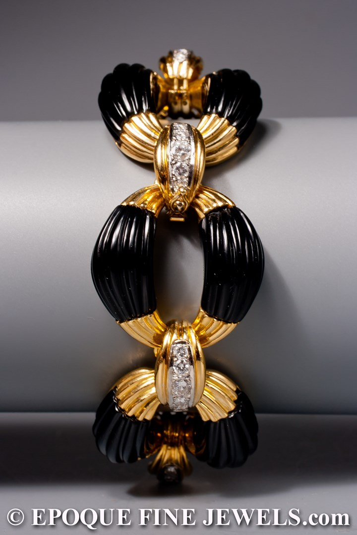 A very stylish onyx and diamond bracelet, retailed by Neiman Marcus,