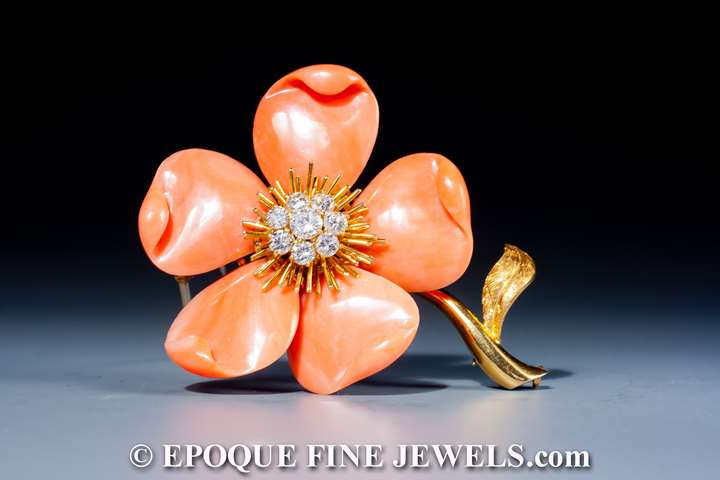 A beautiful coral and diamond flower brooch