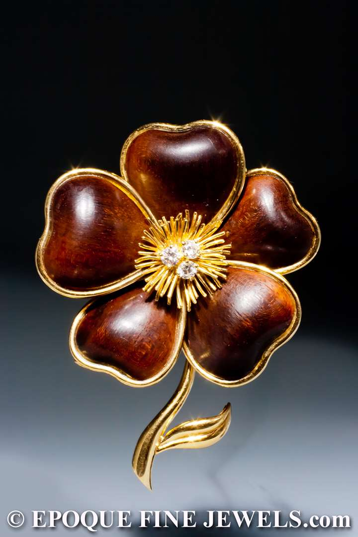 An 18 karat gold and wood 'clematite' flower brooch
