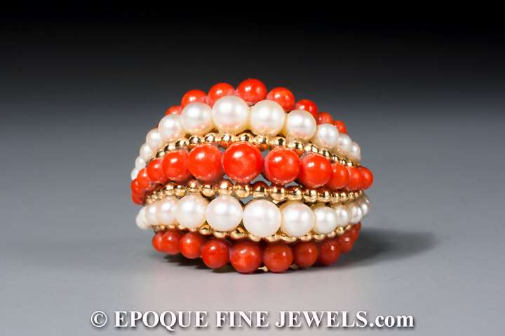 An 18 karat gold, pearl and coral bombé ring