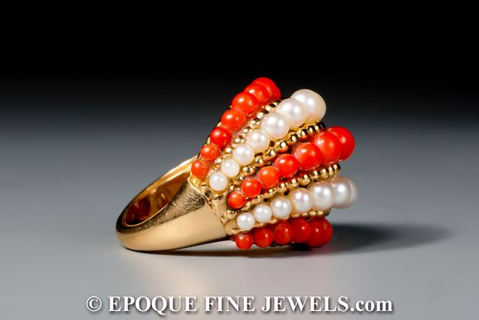Van Cleef & Arpels - An 18 karat gold, pearl and coral bombé ring | MasterArt