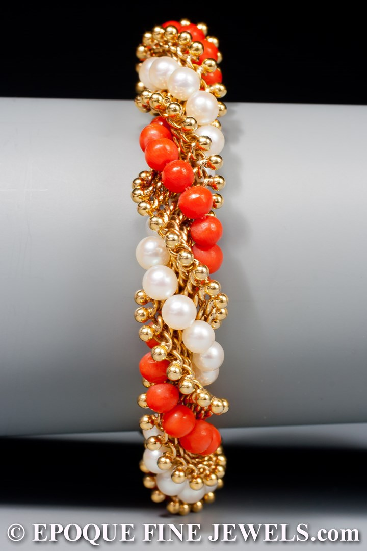 An 18 karat gold, pearl and coral torsade bracelet,