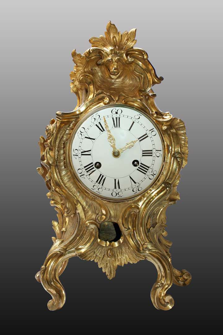 A large Louis XV ormolu-clock by Jean-Baptiste Baillon