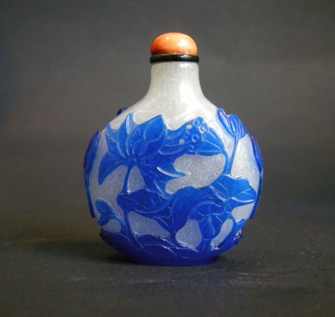 Snuff Bottle glass overlay blue sculpted with Lotus and flowers Qianlong period | MasterArt