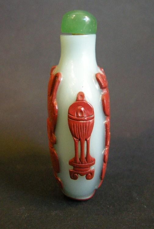Snuff bottle glass overlay red cinnabar on light blue background | MasterArt