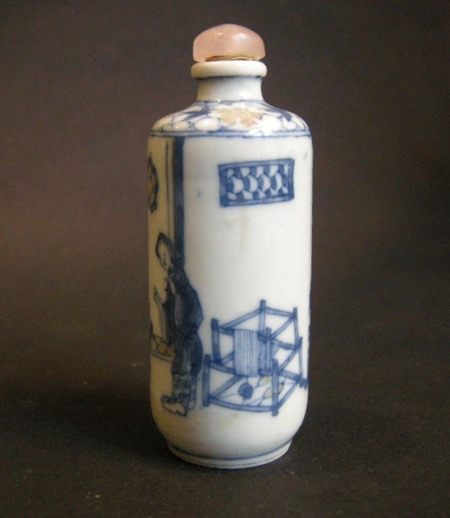 Porcelain snuff bottle decorated in underglaze blue and copper red with interior scene | MasterArt