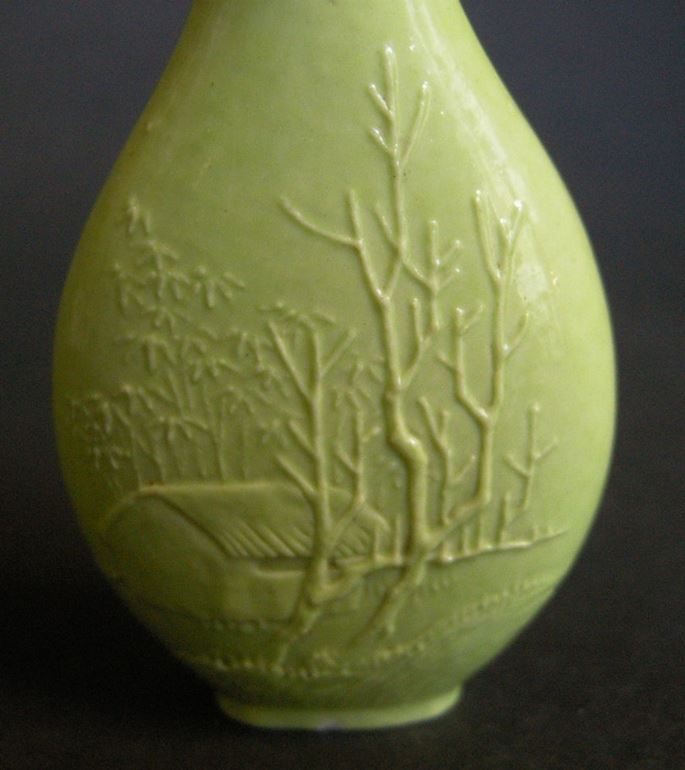 Porcelain snuff bottle in green monochrom sculpted in Wang Bingrong style | MasterArt