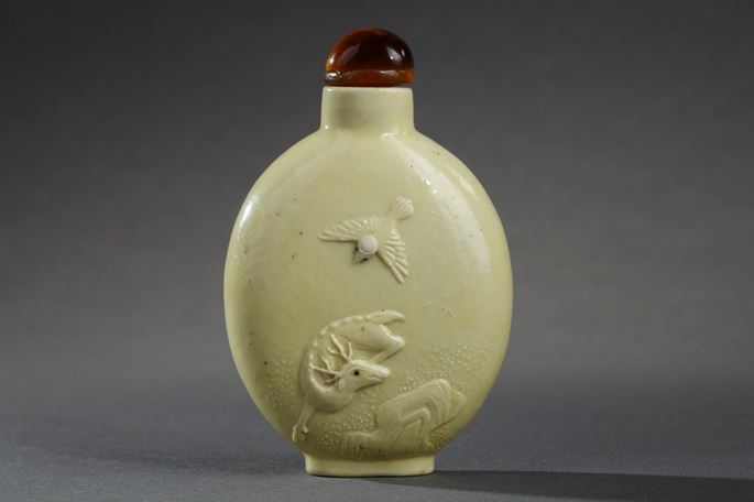 Snuff bottle porcelain enamelled yellow color - sculpted with a monkey on a tree - and other face with a deer and crane | MasterArt