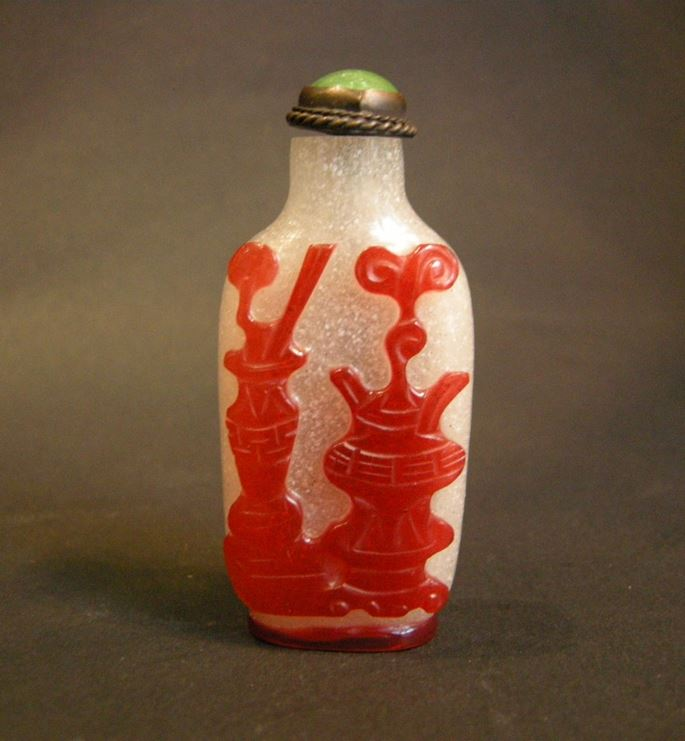 Glass overlay red snuff bottle sculpted on each face with precious vases | MasterArt