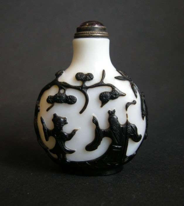 Good overlay snuff bottle finely sculpted with different figures on each face