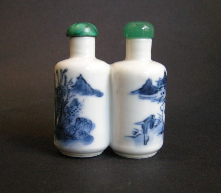 Snuff bottle porcelain double decorated in underglaze blue with landscapes