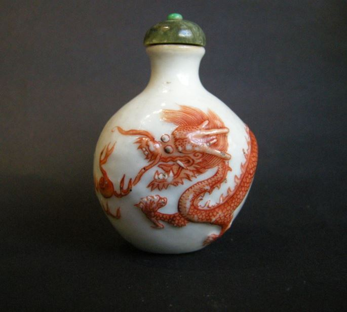 Snuff bottle porcelain with a low relief a Dragon in iron red | MasterArt