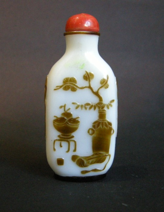 Snuff bottle overlay glass Brown on white ground sculpted with a mobilar decor Yangzhou school   MasterArt