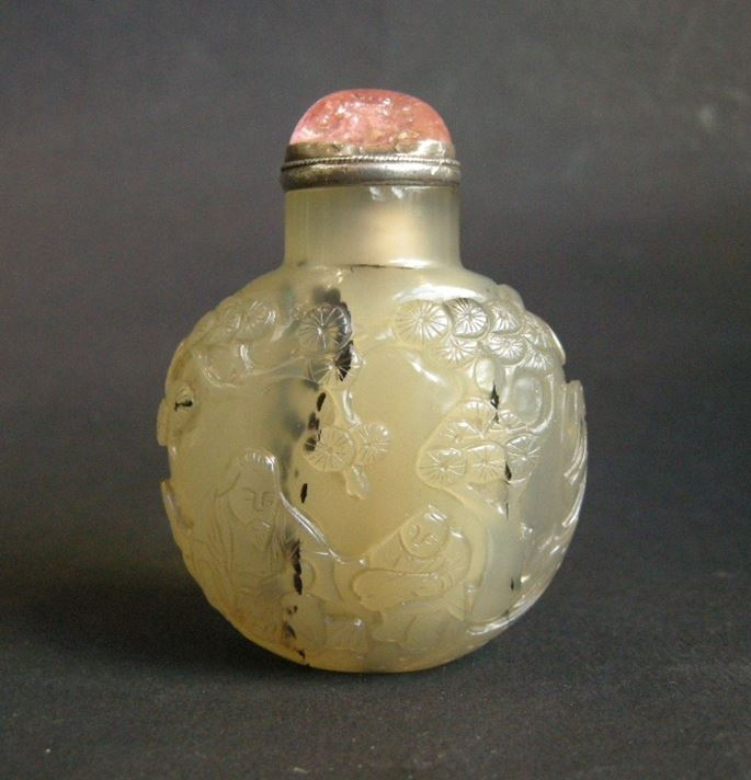 Agate snuff bottle sculpted with scholar and servant in landscape on a face, other with figure in a boat | MasterArt