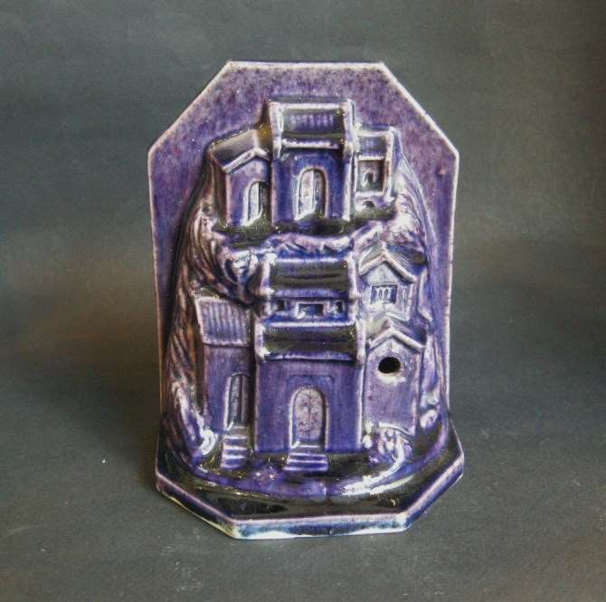 Sculpture porcelain aubergine color probably paperweight in form of houses and rocks