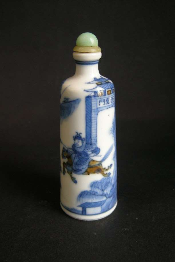 Snuff bottle porcelain decorated in underglaze blue and copper redwith scene of novel