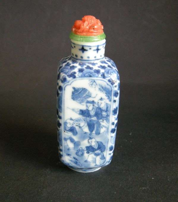 Snuff bottle porcelain blue and white of rectangular shape (for faces) decorated in each face with numerous childrens