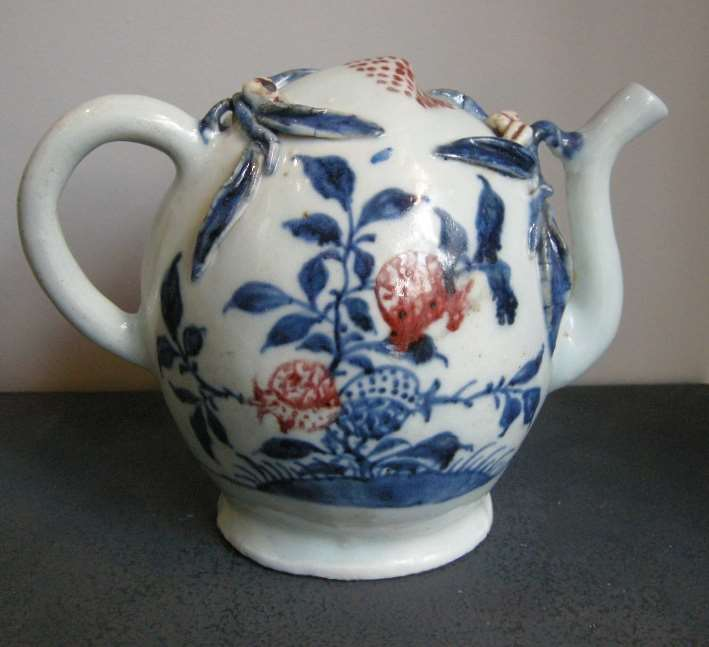 Ewer porcelain cadogan shape enamelled in underglaze blue and copper red with fruit decoration