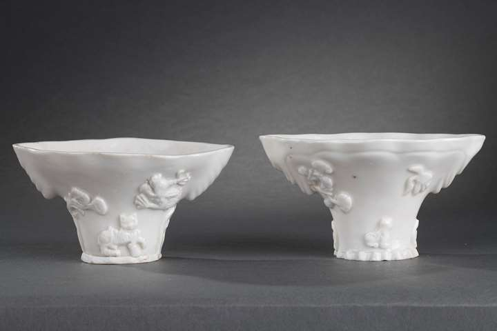 """Pair of """"blanc de Chine"""" rhinoceros horn shaped cups with animals decoration like: tiger dragon deer or crane"""