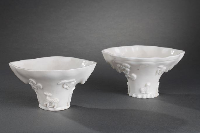 """Pair of """"blanc de Chine"""" rhinoceros horn shaped cups with animals decoration like: tiger dragon deer or crane 