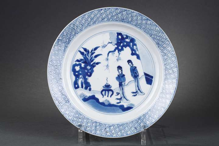 Chinese blue and white porcelain plate with two long Eliza in a garden in front of a censer