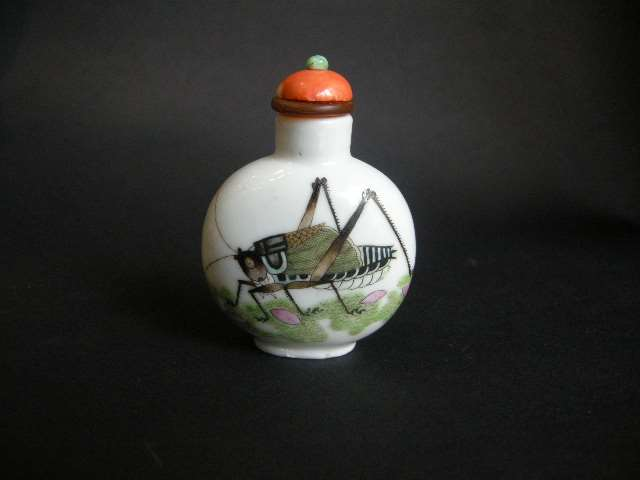 Snuff bottle porcelain with a cricket on a face and other face with butterfly
