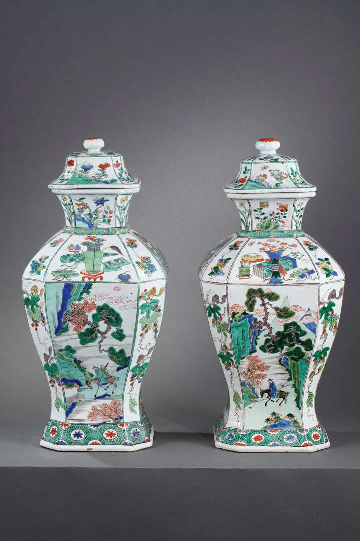 Pair of porcelain Famille Verte large vases and covers, finely painted with landscape and figures with flowers birds and lotus