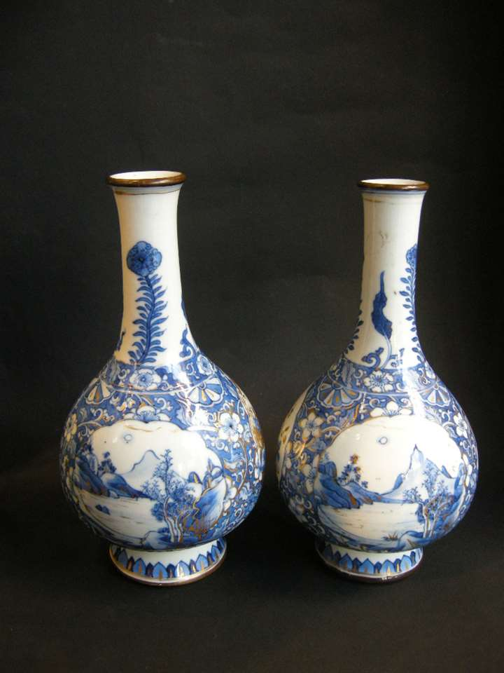 Pair of porcelain bottles blue and white and gold decoration Kangxi period