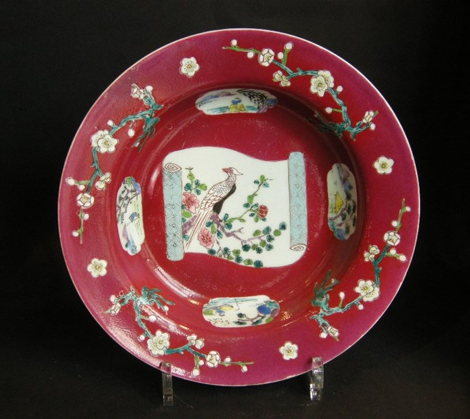 "Plate in ""famille rose"" porcelain on rubis ground - decorated with bird and flowers Yongzheng period 