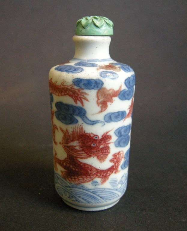 Porcelain Snuff Bottle decorated in underglaze blue and copper red with Dragon