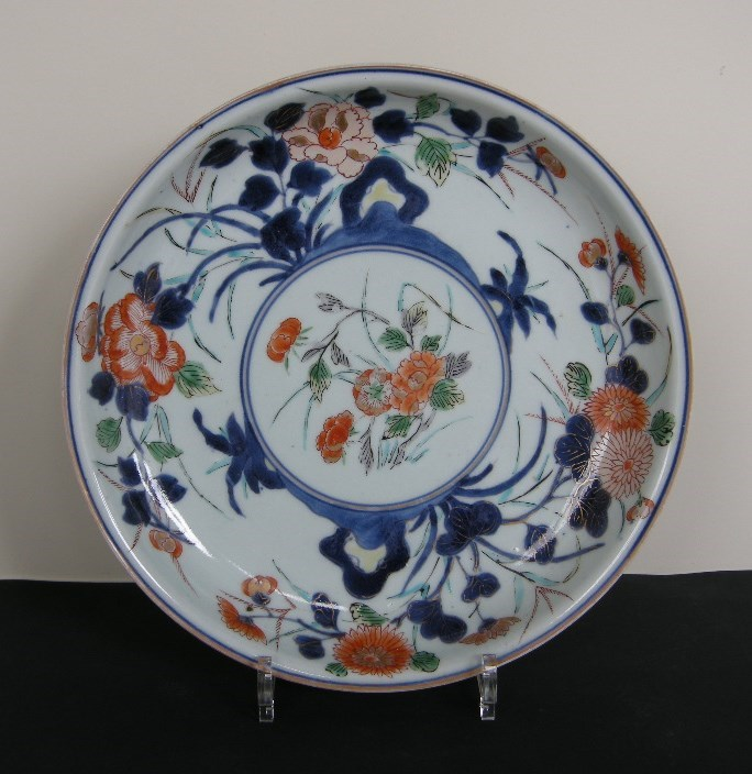 Porcelain dish decorated with flowers enameled in green yellow iron red gold and underglaze blue