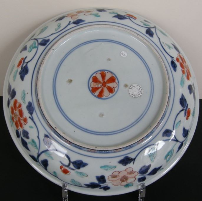 Porcelain dish decorated with flowers enameled in green yellow iron red gold and underglaze blue | MasterArt