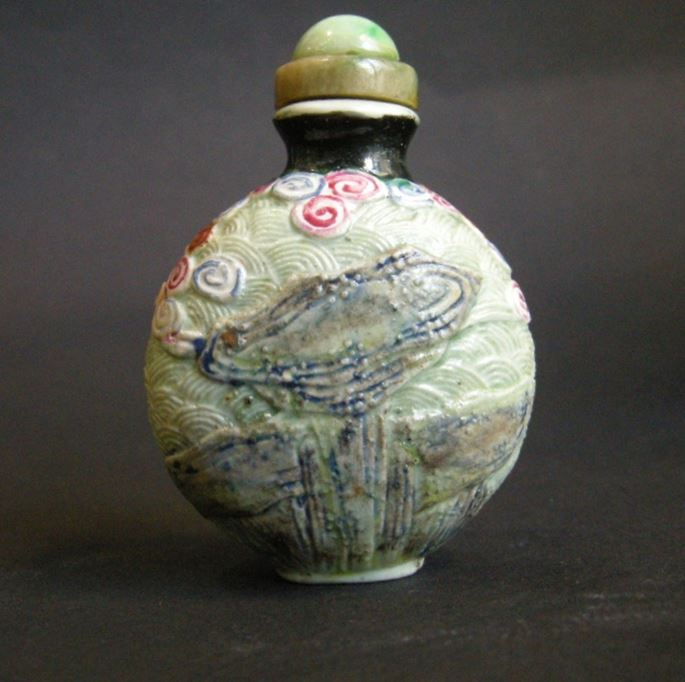 Rare porcelain snuff bottle molded  probably immortal He Xiangu | MasterArt