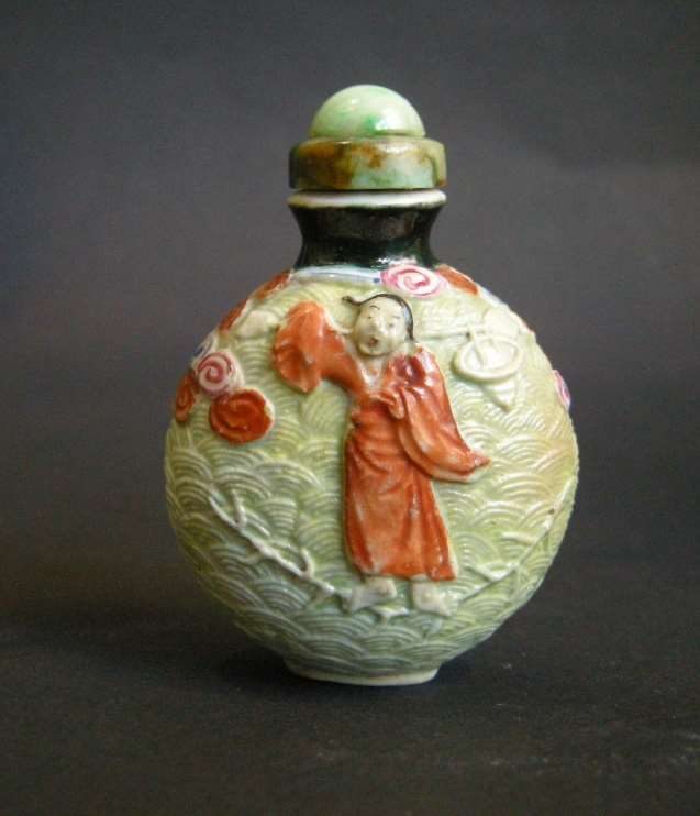 Rare porcelain snuff bottle molded  probably immortal He Xiangu