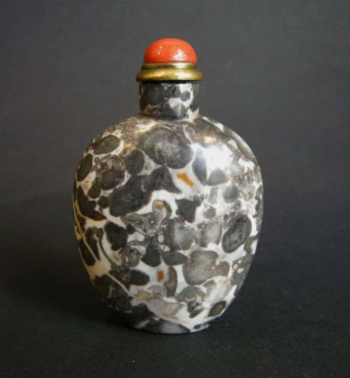 "Rare snuff bottle  fossiliferous stone ""Limestone"" with color white black and a few rust"