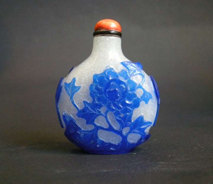 Snuff Bottle glass overlay blue sculpted with Lotus and flowers Qianlong period