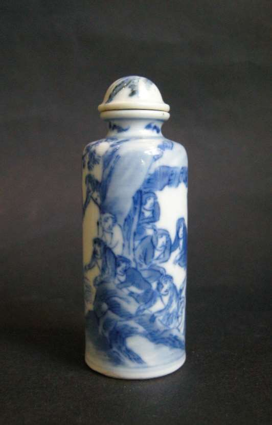 Snuff bottle with a numerous monkeys in a landscape- the Kingdom of monkeys (old stopper porcelain)