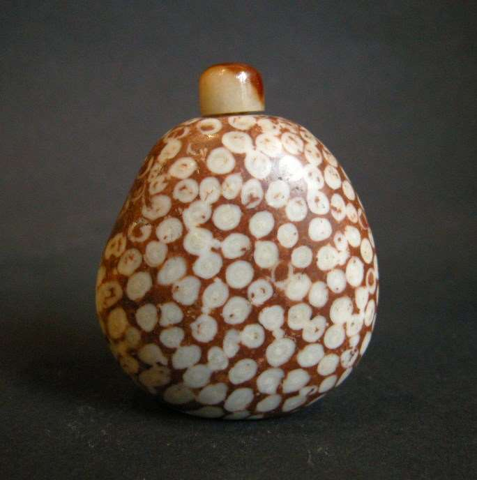 "Snuff bottle fossiliferous stone ""limestone"" of pebble material  with splash white on rust ground"