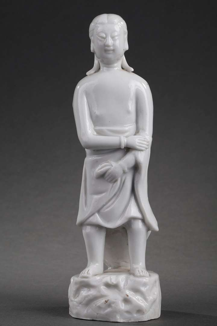 Standing figure of a man traditionally called Adam in Blanc de Chine porcelain