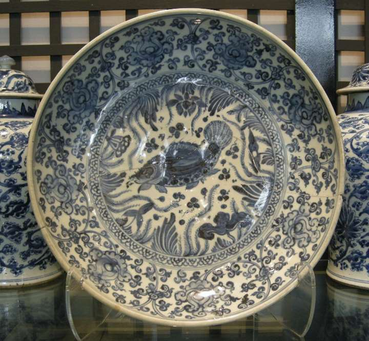 Very rare large dish porcelain blue and white decorated with flowers, fish and aquatics plants