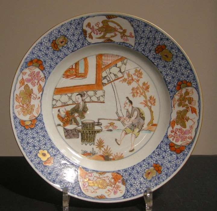 Dish porcelain showing the pressing of apples - Yongzheng period